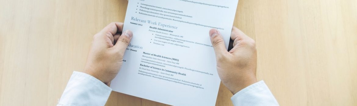 Business man holding his resume during job interview to Executive reading and consider, Hiring concept.